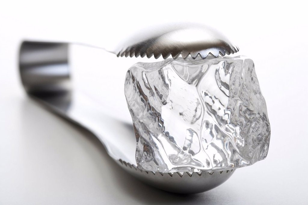 Stock Photo: 1848R-364069 Ice cube tongs holding an ice cube