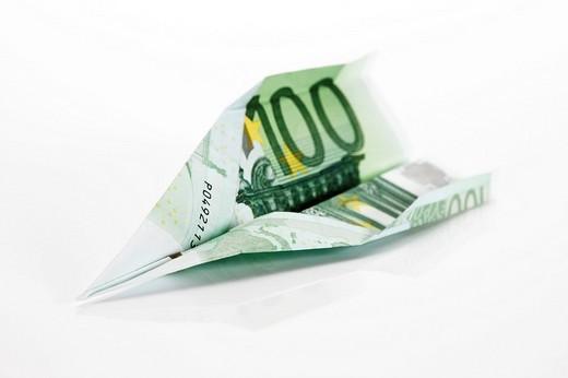 100 euro banknote, paper plane : Stock Photo