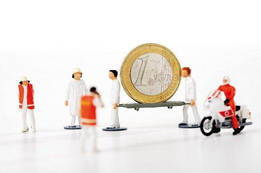 Stock Photo: 1848R-365089 Nurses carrying stretcher with one-Euro coin: symbol for rising medical costs