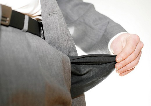 Stock Photo: 1848R-365108 Business manager with no money in his pocket is totally washed out