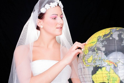 Bride deciding on a honeymoon destination : Stock Photo