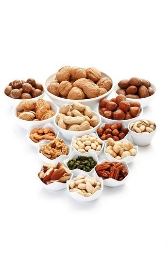 Stock Photo: 1848R-365351 Assorted nuts and kernels in ceramic bowls, pecans, walnuts, hazelnuts, macadamia nuts, peanuts, almonds, pistachios, and Brazil nuts