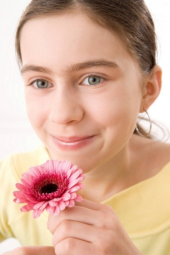 Girl smelling a flower : Stock Photo