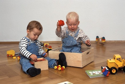 One and one-and-a-half-year-old boys playing : Stock Photo
