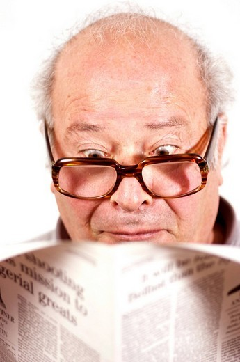 Man reading a newspaper : Stock Photo