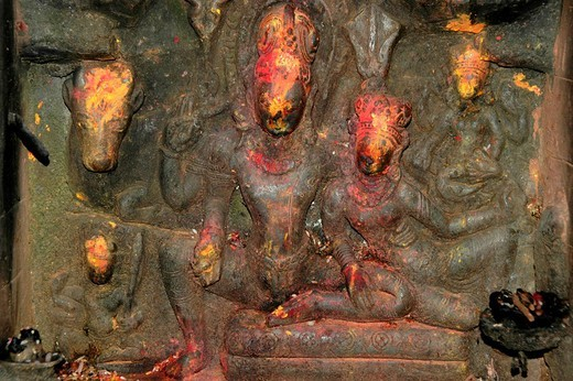 Old relief shows god Shiva with Parvati and many more figures with red paint Kathmandu Nepal : Stock Photo