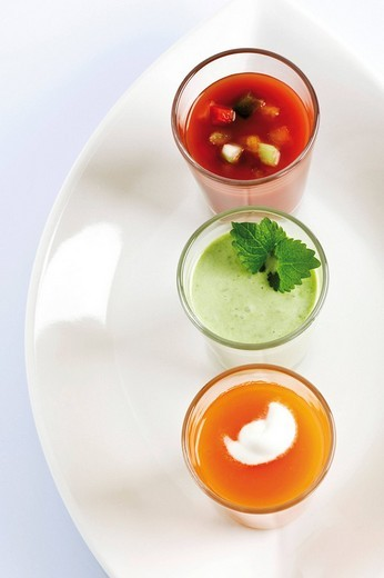 Stock Photo: 1848R-369474 Three soups in glasses, gazpacho, cucumber soup, pumpkin soup
