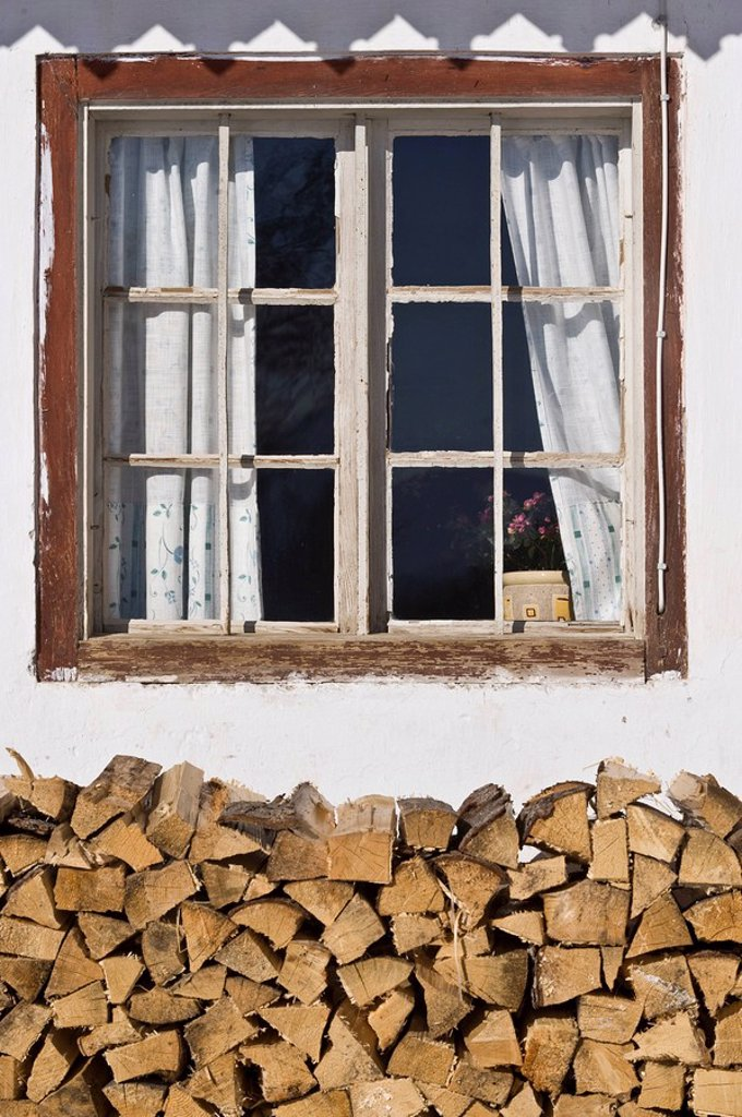 Stock Photo: 1848R-370683 Window with pile of wood, Achenkirch, Tyrol, Austria