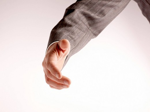 Stock Photo: 1848R-370881 Business man offering his hand
