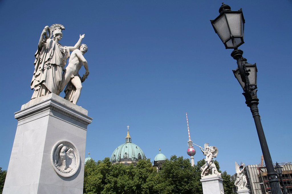 On Schloßbrücke castle bridge between Unter den Linden and Karl-Liebknecht-Street, Berlin center: Statues of Karl Friedrich Schinkel, dome of Berlin cathedral, TV tower and historical street lamp, Berlin, Germany, Europe : Stock Photo