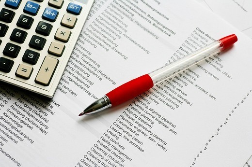 Stock Photo: 1848R-372715 Calculator and red pen on a technical description