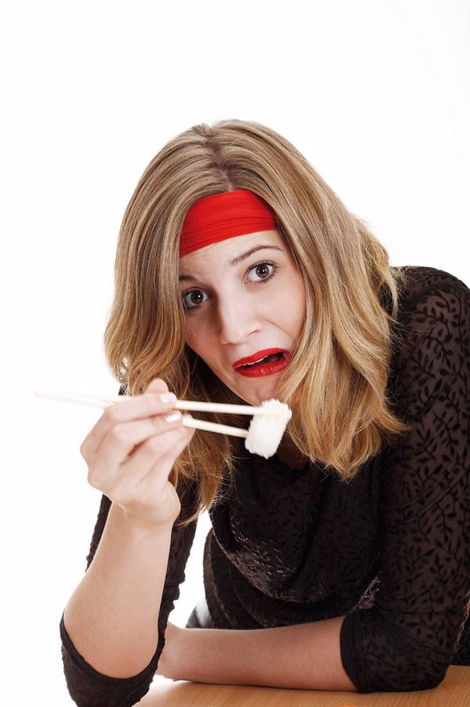 Young woman disgusted of sushi : Stock Photo