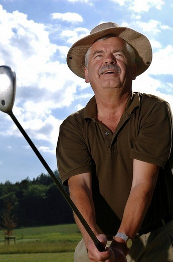64 year old man playing golf : Stock Photo