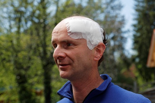 Portrait of a man, 45, with an adhesive bandage on his head, Geretsried, Bavaria, Germany, Europe : Stock Photo