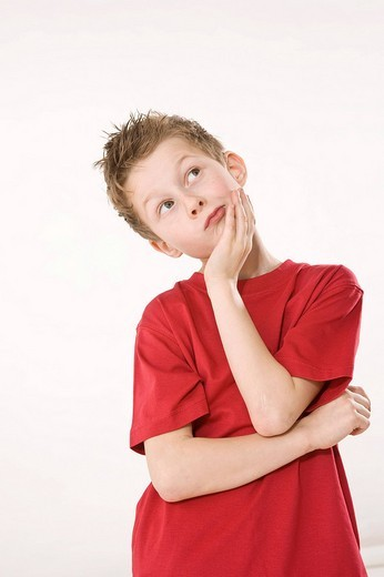 Portrait of a thoughtful looking boy : Stock Photo