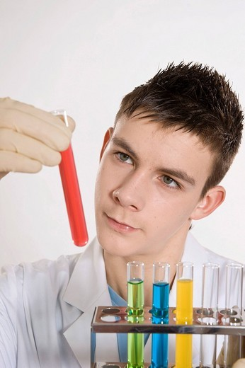 Stock Photo: 1848R-375817 Teenage boy working in a laboratory, checking a test tube