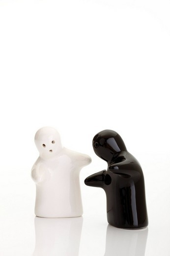The encounter - symbolic picture - ghost salt and pepper shakers : Stock Photo