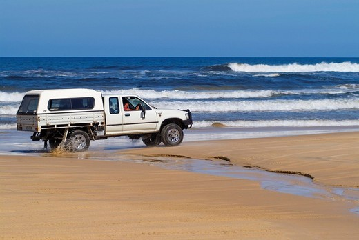 Stock Photo: 1848R-376535 Off-road pick-up truck driving on the beach, Fraser Island, Queensland, Australia