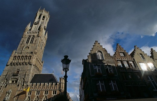 Tower Belfried and historic houses on marketplace city of Brugge Belgium : Stock Photo