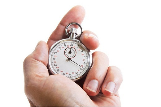 Stock Photo: 1848R-377668 Hand holding a stopwatch