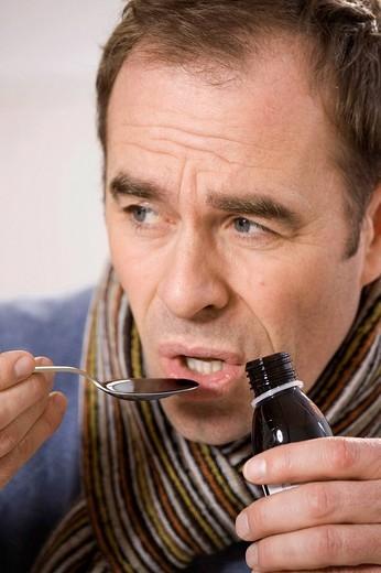 Ill man taking medicine : Stock Photo