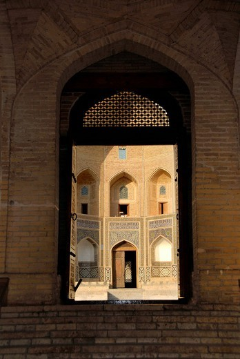Stock Photo: 1848R-378242 View through the entrance gate of Mosque Kalon to Mir-i Arab-Madrasah Bukhara Uzbekistan
