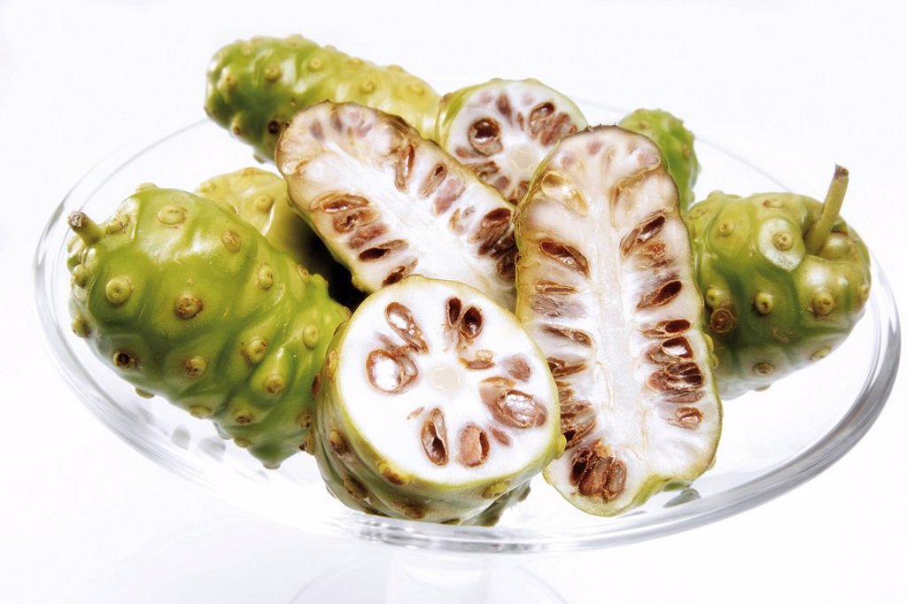Fresh noni fruit in a cocktail glass : Stock Photo