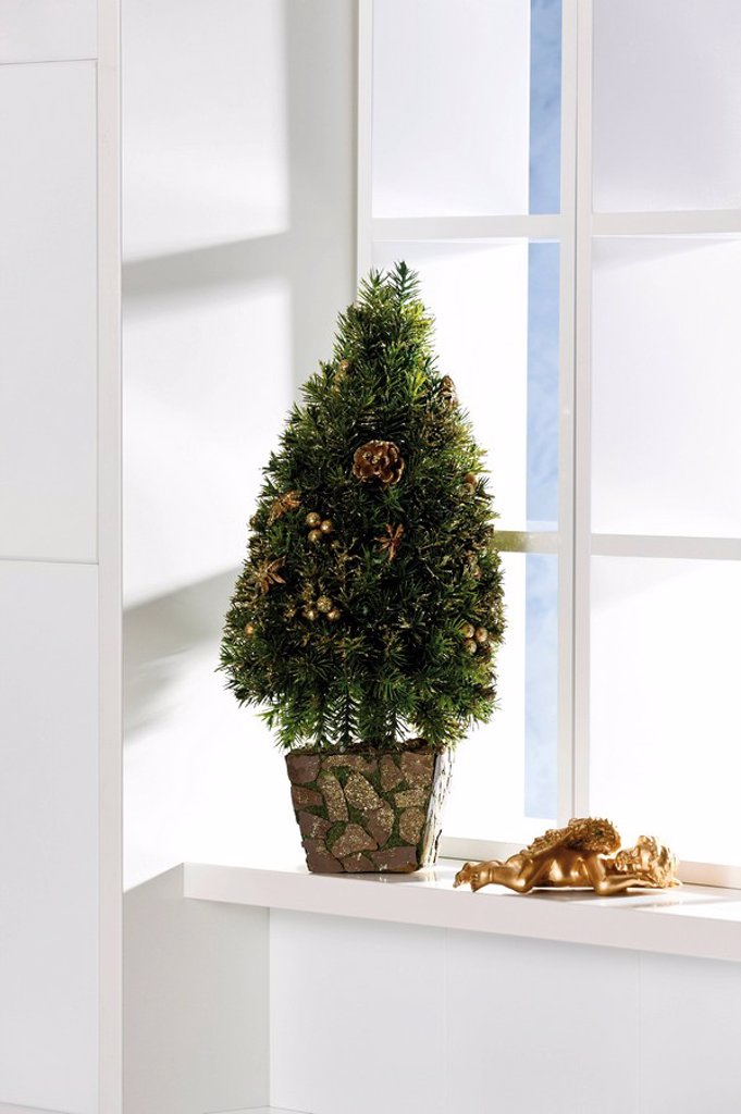 Christmas tree decoration on a windowsill : Stock Photo