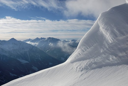Massive snow drift at the ridge of alpine peak in the Zillertal alps Tyrol Austria : Stock Photo