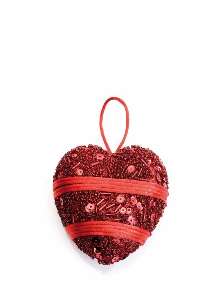 Stock Photo: 1848R-382616 Embroidered red heart ornament