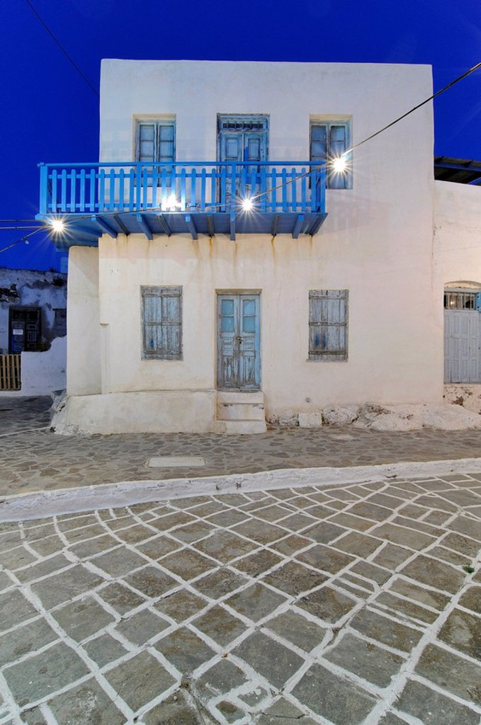 Greek house at night with artificial lighting, paving stones with tiles and white joints, Milos, Plaka, Cyclades, Greece, Europe : Stock Photo