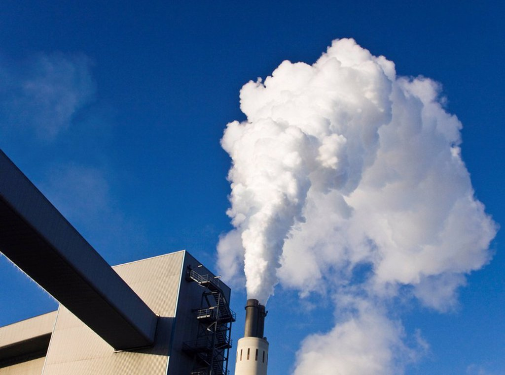 Chimney of a power station : Stock Photo