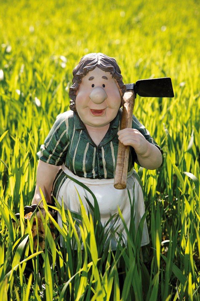 Stock Photo: 1848R-384808 Gardener´s wife, farmer´s wife figurine in a wheat field