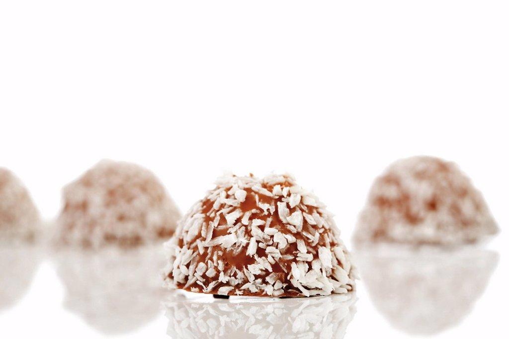 Stock Photo: 1848R-384861 Coconut and chocolate-coated marshmallow treats