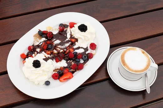 Pancakes with berries and cream, cappuccino, Burgenland, Austria, Europe : Stock Photo