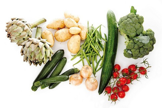Mixed vegetables, artichokes, broccoli, potatoes, zucchini, onions, beans, cucumber and tomatoes : Stock Photo