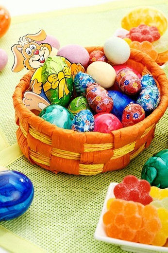 Easter basket, Easter eggs and Easter candies : Stock Photo