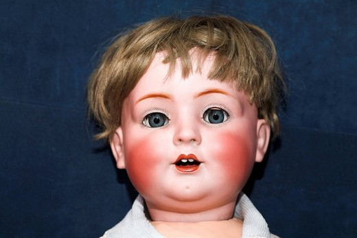 Head of an old doll : Stock Photo