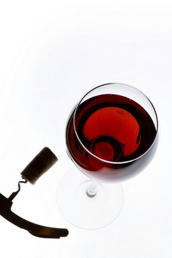 Stock Photo: 1848R-387808 Corkscrew and a glass of wine