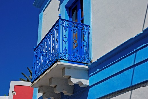 Balcony adorned with a bright blue wrought-iron railing, Stromboli Island, Aeolian Islands, Southern Italy : Stock Photo