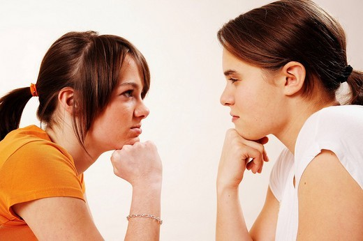 Stock Photo: 1848R-392313 Two female teenagers arguing