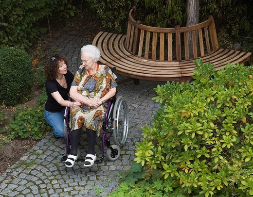 Stock Photo: 1848R-393250 95 year old grandmother talking to her granddaughter