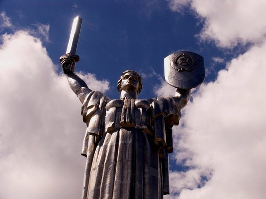 Stock Photo: 1848R-393867 Ukraine Kiev mother of native country monumental memorial 1982 made in steel sword and shield shining close up blue sky with clouds 2004