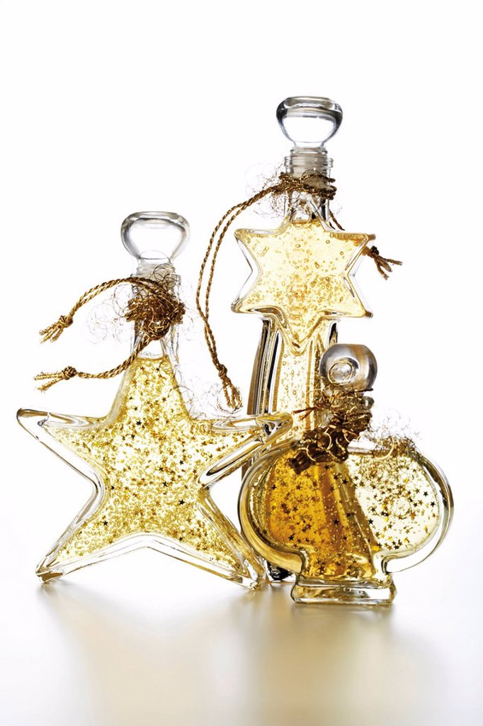Cosmetic bottles with golden glitter, Christmas decoration : Stock Photo