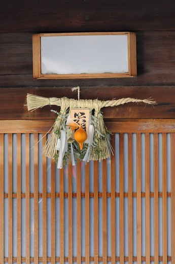 Stock Photo: 1848R-396631 Shimenawa, straw rope hung over the entrance door at the New Year´s festival, Shinto tradition, Kyoto, Japan, Asia