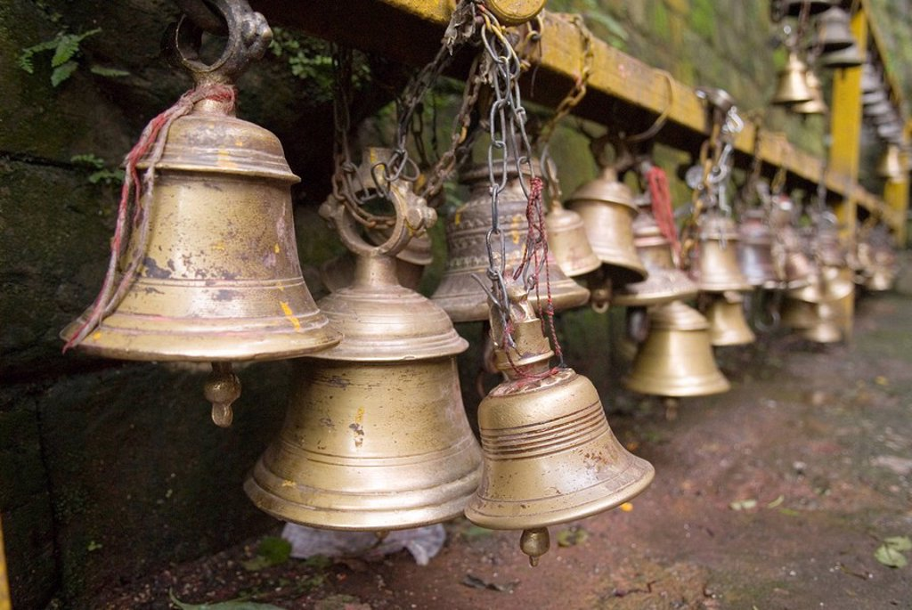 Brass bell at a Kali temple, Dakshinkali, Kathmandu valley, Nepal : Stock Photo