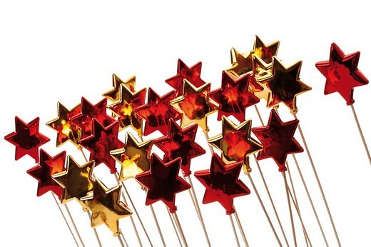 Red and golden stars on sticks : Stock Photo