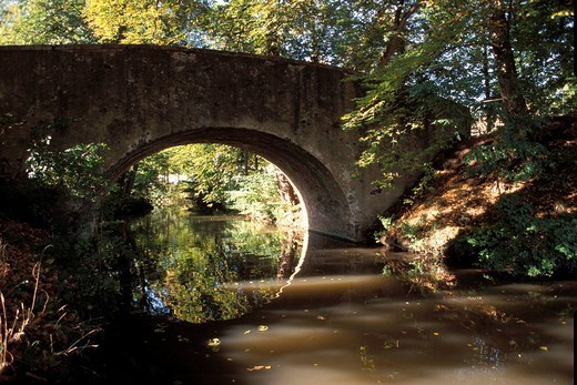Germany, old bridge in the park of the former spa park area named Wilhelmbad in Hanau : Stock Photo