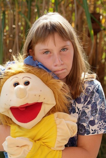 Girl with hand puppet : Stock Photo