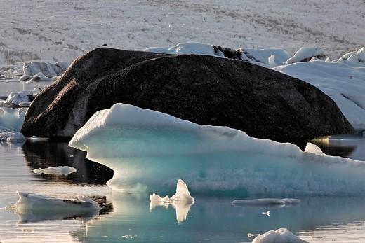 Icebergs, the darker ones coloured by volcanic ash, Joekulsarlon glacial lake, southern coast of Iceland, Atlantic Ocean : Stock Photo
